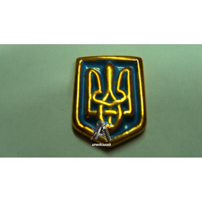 Емблема тризуб на щиті золота