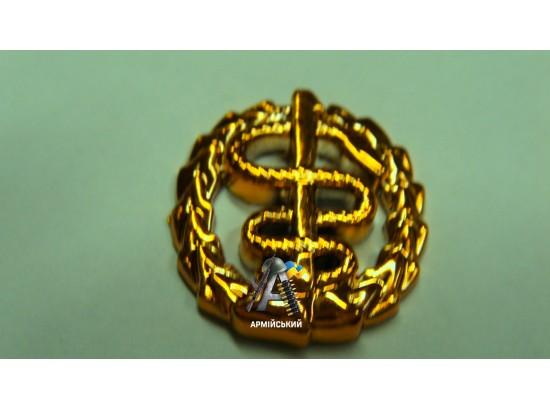 Эмблема медиков золотая