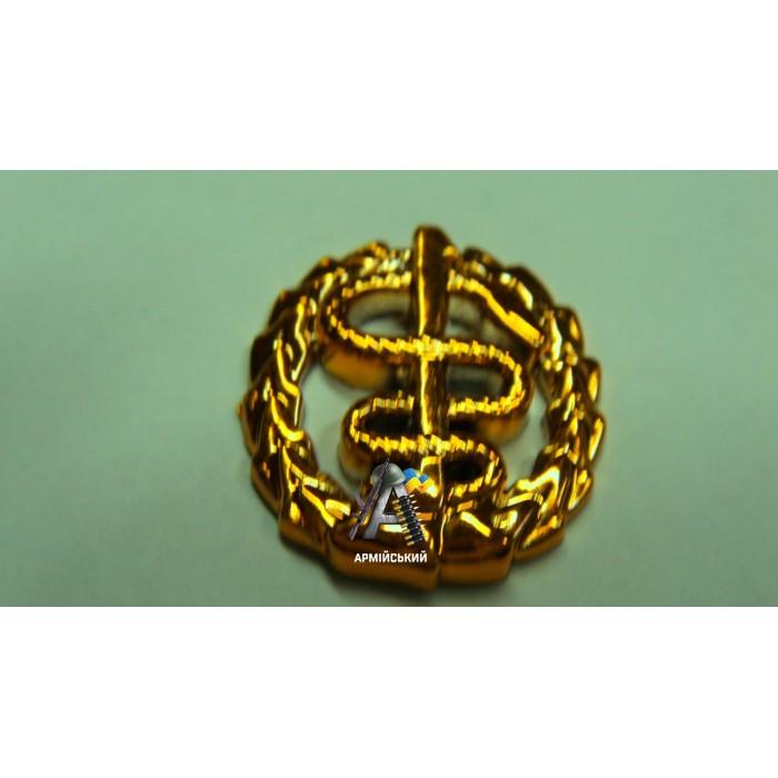 Емблема медиків золота