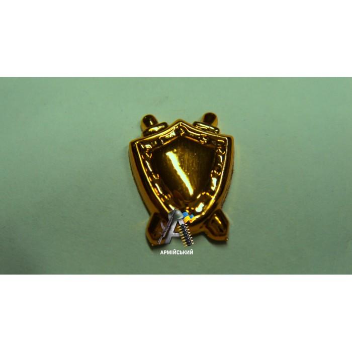Емблема юстиції маленька, золота