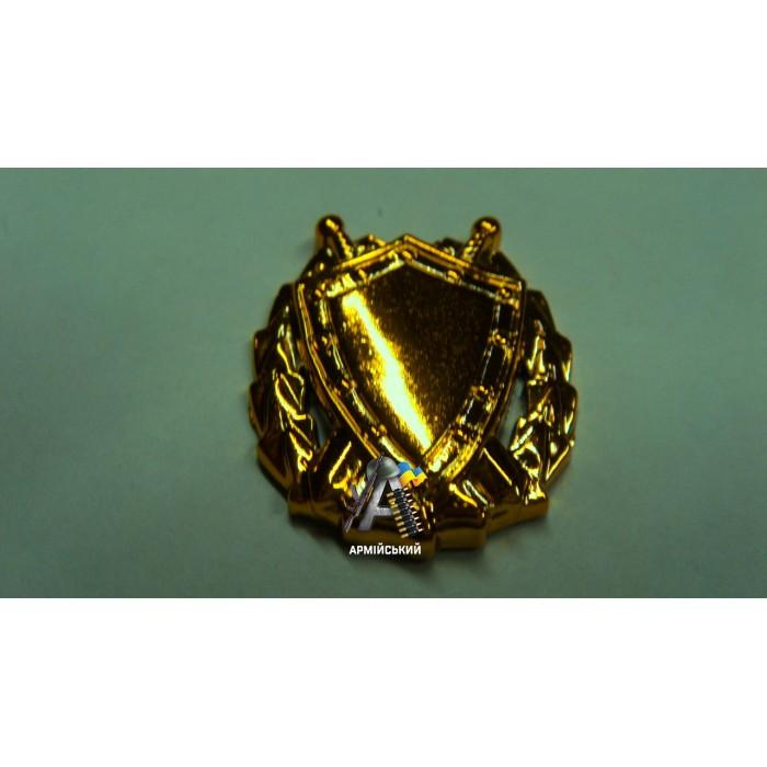 Емблема юстиції золота